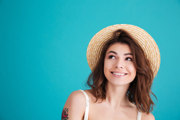 Close up portrait of a smiley young girl in straw hat