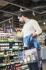 Man buying groceries at supermarket