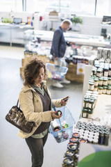 High angle view of mature man and woman shopping in supermarket