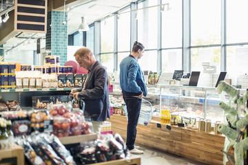 Men shopping in organic grocery store