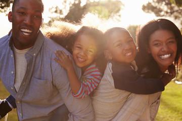Portrait Of Happy Family In Summer Garden