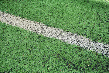 Soft focused picture of  white line in  Football field  or soccer field covered with artificial grass