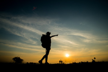 silhouette of backpacker