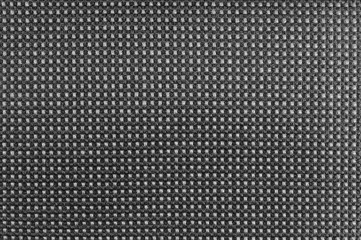 Grey nylon textile texture macro closeup, gray horizontal pattern detail, textured salt and pepper style black and white melange synthetic fabric, detailed background
