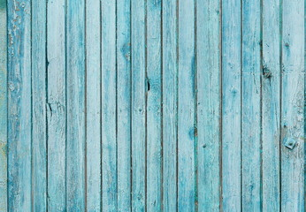 Texture of vertical wooden planks with peeling turquoise blue color paint. Detailed background photo texture. vintage
