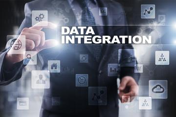 Businessman selecting data integration on virtual screen.
