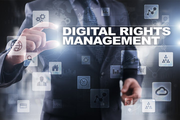 Businessman selecting digital rights management on virtual screen.