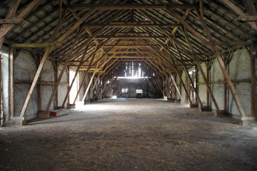 Wooden rural barn with big supports