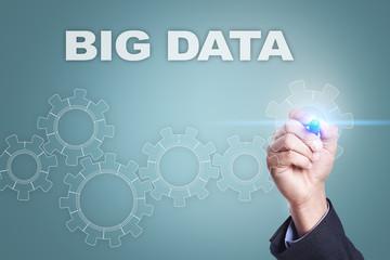 Businessman drawing on virtual screen. big data concept