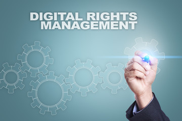 Businessman drawing on virtual screen. digital rights management concept