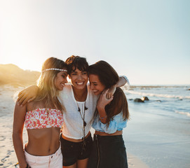 Female friends walking together at the beach
