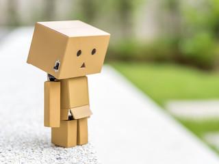Depressed box doll
