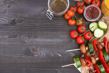 Grilled vegetarian meal on the wooden table, top view. Barbecue party outdoor