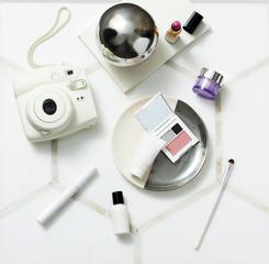 Flat lay feminine arrangement with retro camera