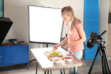 Young woman preparing for shooting food in photo studio