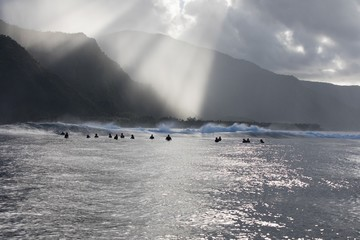Group of surfers waiting for a wave, Tahiti