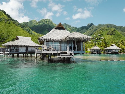 Overwater bungalows, in remote setting