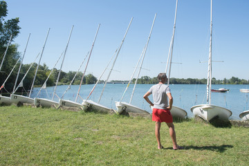 handsome sailing teacher checks condition before courses