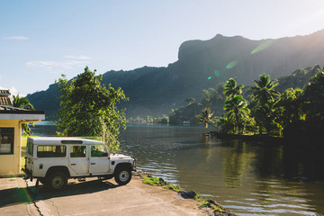 Four wheel drive by riverside and mountains, Mo'orea, South Pacific