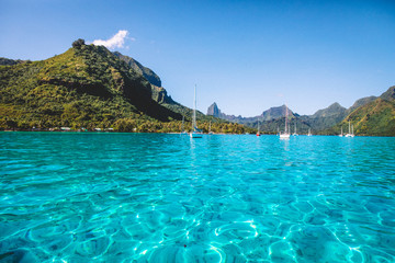 Boats, sea and mountains in sunshine, Mo'orea, South Pacific
