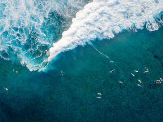 Aerial of surfers in sea, Teahupoo, Tahiti, South Pacific