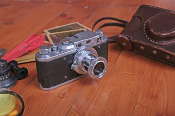 Vintage old film photo-camera in leather case