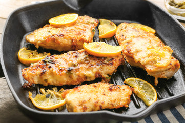 Frying pan with delicious chicken piccata, closeup