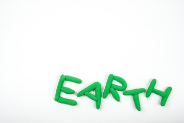 Letter earth made from plasticine isolated on a white background