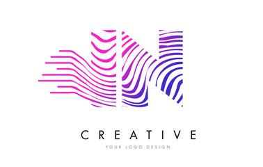 IN I N Zebra Lines Letter Logo Design with Magenta Colors