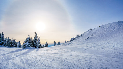 Wall Mural - Sun trying to break through the clouds in the high alpine of the ski resort of Sun Peaks in the Shuswap Highlands of central British Columbia, Canada