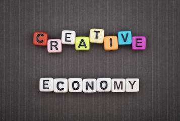 CREATIVE ECONOMY, by colorful alphabet beads