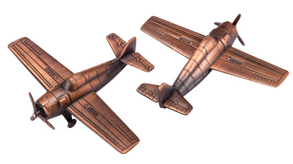 Airplane toy metal with a propeller. Bronze color. Isolated on white