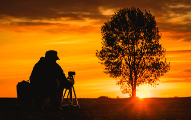 Nature photographer silhouette the sunset