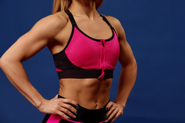 Sport. Woman sport body strong and beautiful