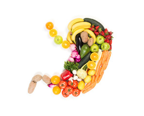 Stomach made out of fruits and vegetables isolated on white background