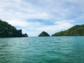 Island  under sun shine beautiful emerald sea and blue sky in summer of Andaman sea Trang province Thailand