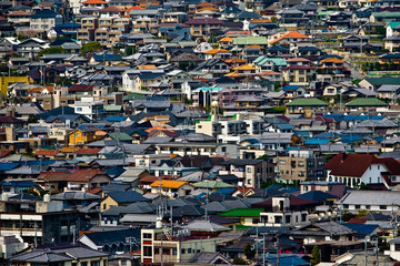Aerial view over the rooftops of residential houses in Himeji, Japan.