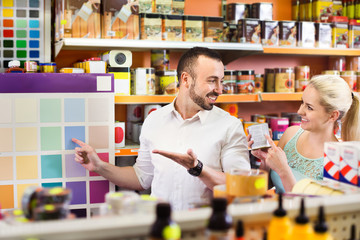 Couple choosing color in household store