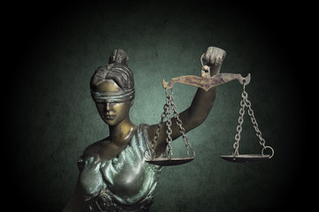 Lady Justice on grunge emerald background
