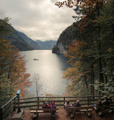 Relax at Konigssee lake. View of Koenigssee (King's Lake) surrounded by alpine mountains from Malerwinkel viewpoint in Autumn. Beautiful scenery of Bavarian countryside in Berchtesgaden Germany.