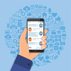 Hand with smartphone chat on background with social media icons