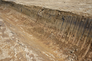 A channel for the drainage of the water that was dug with a bulldozer