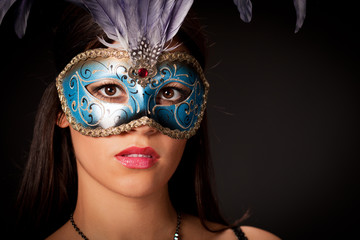 Beautiful young woman with mask .