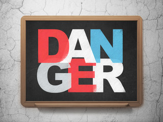 Protection concept: Danger on School board background