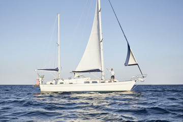 "Mediterranean Sea, ""Goldene Rente"", mature man enjoying the ride on his sailing boat"