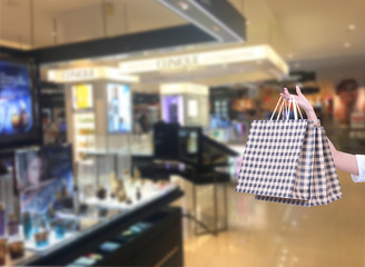 Beauty Woman with Shopping Bags in Shopping Mall. Shopper. Sales. Shopping Center..