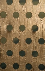 Gold textured background with cut out circles