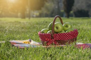 Fotobehang Picknick Green apples in a basket