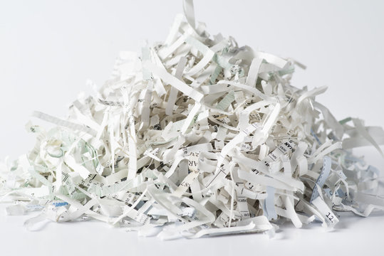 Pile of shredded paper on white background