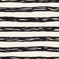 Decorative seamless pattern with handdrawn doodle lines. Hand painted wavy stripes background. Trendy endless freehand texture